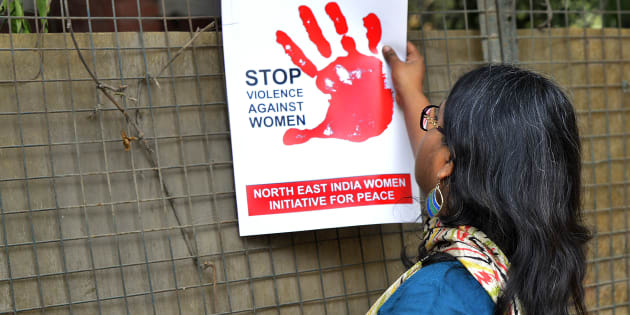 FILE PHOTO: A woman protests against the brutal assault and rape of 24 year old girl in Hauz Khas village in New Delhi.
