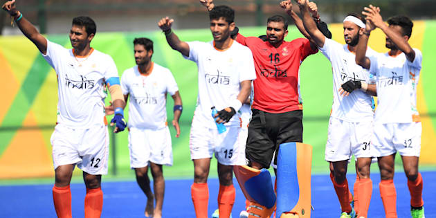 India players celebrate after the men's field hockey Argentina vs India match of the Rio 2016 Olympics Games.
