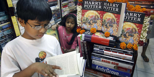 A young reader reads leafs through a copy of Harry Potter and the Deathly Hallows at a bookshop in New Delhi.