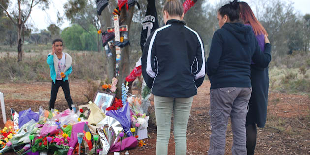 Mourners pay their respects at a tribute to dead teen Elijah Doughty in August