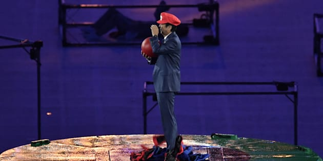 Japanese Prime Minister Shinzo Abe, dressed as Super Mario, holds a red ball during the closing ceremony of the Rio 2016 Olympic Games at the Maracana stadium in Rio de Janeiro on August 21, 2016. / AFP / PHILIPPE LOPEZ        (Photo credit should read PHILIPPE LOPEZ/AFP/Getty Images)
