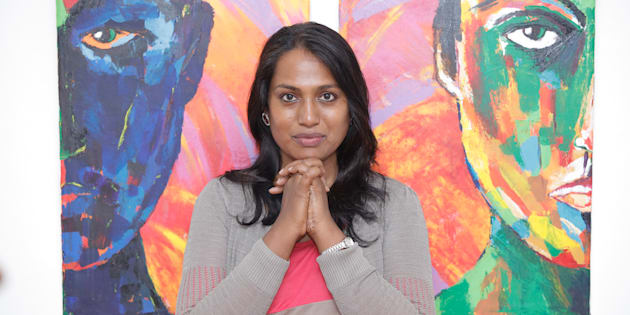 Transgender artivist Kalki Subramanium stands in front of one of her paintings