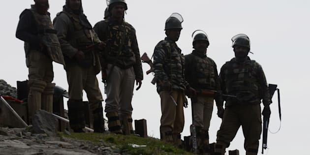 Indian paramilitary soldiers guard outside a polling station during a re-polling of a by-election for a vacant seat in India's Parliament in Dooniwari, on April 13, 2017 in Kashmir, India.  The re-poll was ordered by Indian authorities in 38 polling centers after Sundays voting process was disrupted by violence that killed eight civilians.  PHOTOGRAPH BY Imran Bhat / Barcroft Images  London-T:+44 207 033 1031 E:hello@barcroftmedia.com - New York-T:+1 212 796 2458 E:hello@barcroftusa.com - New Delhi-T:+91 11 4053 2429 E:hello@barcroftindia.com www.barcroftimages.com (Photo credit should read Imran Bhat / Barcroft Images / Barcroft Media via Getty Images)