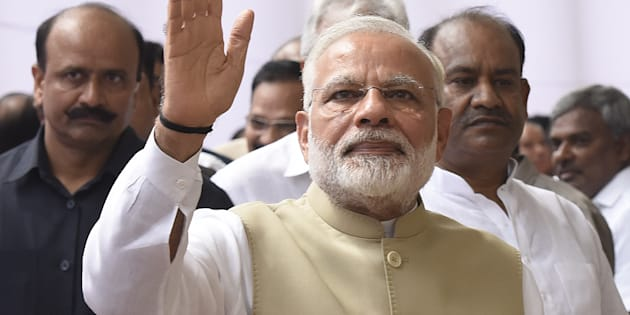 Prime Minister of India Narendra Modi waves his hand after casting his vote during the presidential election, at the Parliament House on July 17, 2017 in New Delhi, India.