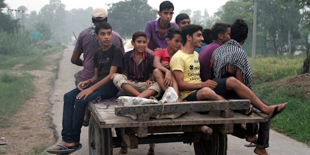 Border villagers migrating after government asked people to vacate their villages falling in 10 km range of international border with Pakistan as a precautionary measure following India's surgical strikes in PoK, at R S Pura in Jammu on Thursday.