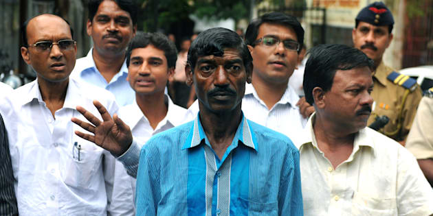 Bhaiyalal Bhotmange (centre) arrives for a press conference in Mumbai on 28 July 2010. SAJJAD HUSSAIN/AFP/Getty Images