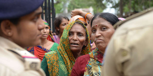 A Dalit woman waits for a relative's release from a police station after protestors were detained by police for damaging vehicles and disturbing peace, at Dholka town, some 40 kms from Ahmedabad on July 21, 2016.