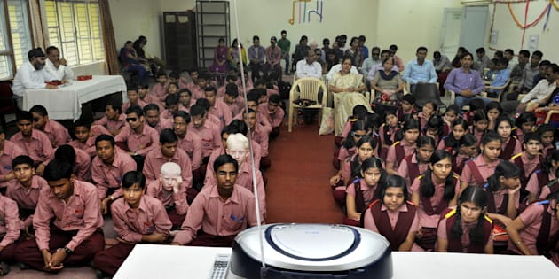 Students listening on the radio a broadcast by Indian Prime Minister Narendra Modi delivering his Teachers' Day speech.