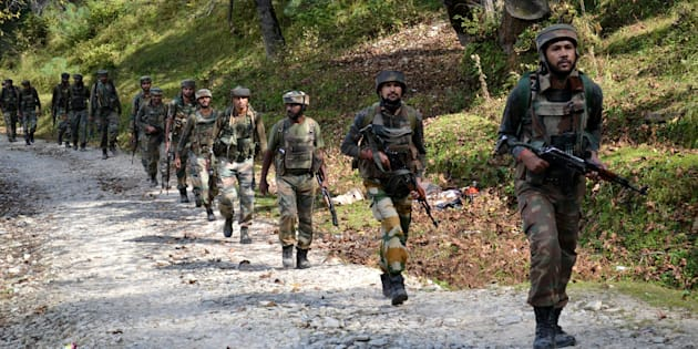 FILE PHOTO: Indian army soldiers taking positions at Hafruda forest in Kashmir's Kupwara district during a gunfight with militants on 5 October 2015.