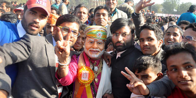A BJP supporter wearing a mask of Modi during the rally of Prime Minister Narendra Modi at Parade Ground on December 27, 2016 in Dehradun, India.
