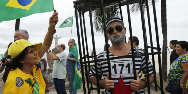 Protesters take part in a demonstration to demand the impeachment of suspended President Dilma Rousseff  on Copacabana beach