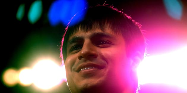 "Bollywood star Vivek Oberoi smiles after being declared recepient of the ""Best Newcomer - Male"" award at the Indian movie awards in Bombay March 28, 2003. REUTERS/Sherwin Crasto  SC"