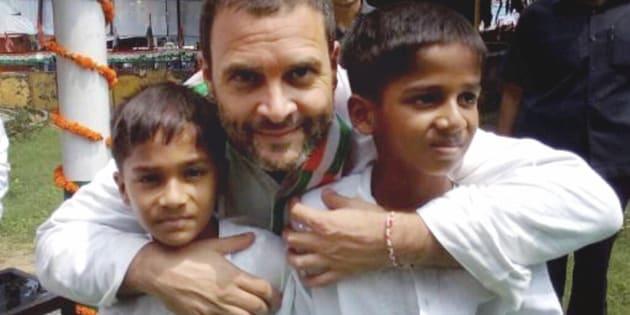 Congress Vice President Rahul Gandhi with children at Acharya Narendra Dev Park during his Kisan Yatra in Faizabad.