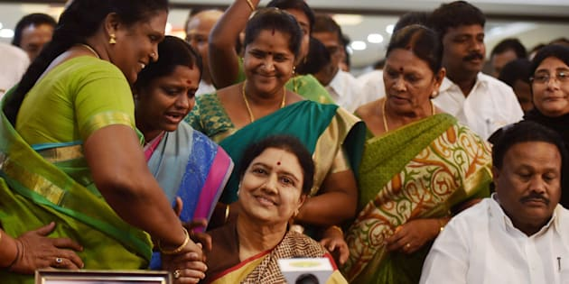 Chennai: AIADMK General Secretary VK Sasikala along with party's MLAs during the press conference at the resort in Koovathur at East Coast Road where various AIADMK MLAs are camping to decide on the further course of action in forming new government, outskirts of Chennai on Sunday. PTI Photo by R Senthil Kumar(PTI2_12_2017_000222B)