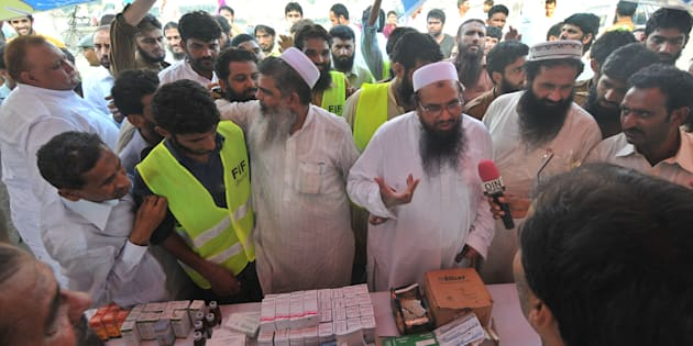 Hafiz Mohammad Saeed, chief of Pakistan's outlawed Islamic hardline Jamaat ud Dawa (JD), visits a medical camp in Lahore. Arif Ali/AFP/Getty Images