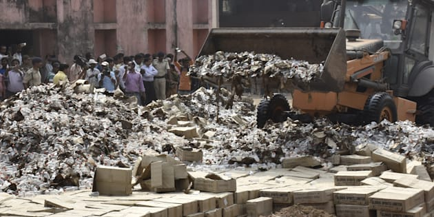 File photo of bottles of country liquor being destroyed on March 31, 2016 on the outskirts of Patna, India.