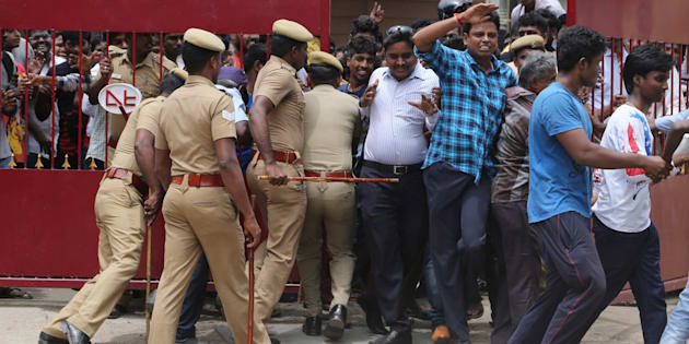 """REPRESENTATIVE IMAGE: Policemen try to maintain the order of the fans of Indian superstar Rajinikanth as they enter the premises of a cinema hall where the actor's new movie """"Kabali"""" is being screened in Chennai, India, Friday, July 22, 2016."""