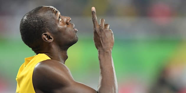 Usain Bolt points skyward before the start of his 100-meter semifinal on Sunday, Aug. 14, 2016 at the Rio Games in Brazil. Later that night, Bolt won the final. (Mark Reis/Colorado Springs Gazette/TNS via Getty Images)