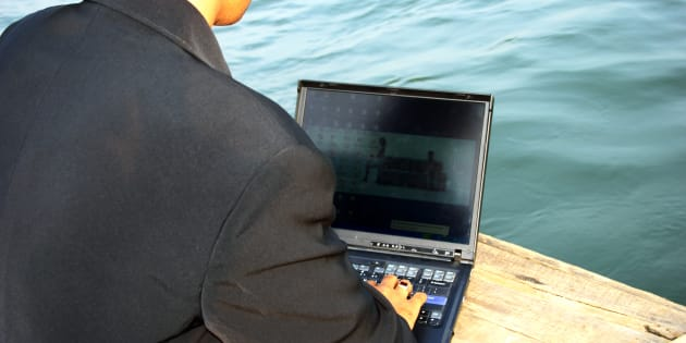 Close up shot of a businessman working on a laptop