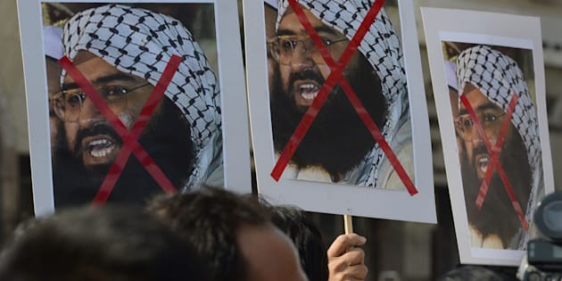 Activists carry placards showing Jaish-e-Mohammad Chief Masood Azhar during a protest against the attack on the air force base in Pathankot. Mumbai, January 4, 2016. INDRANIL MUKHERJEE/AFP/Getty Images