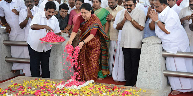 All India Anna Dravida Munnetra Kazhagam (AIADMK) leader VK Sasikala pays her respects at the memorial for former state chief minister Jayalalithaa Jayaram before leaving to surrender to authorities, following a Supreme Court ruling, in Chennai on February 15, 2017.