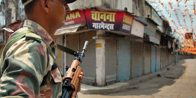 REPRESENTATIVE IMAGE: Security Personnel guards during the curfew after clash between two communities over a land on July 27, 2014 in Saharanpur.