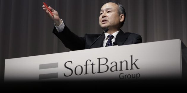 Billionaire Masayoshi Son, chairman and chief executive officer of SoftBank Group Corp., gestures as he speaks during a news conference in Tokyo, Japan, on Monday, Nov. 7, 2016.