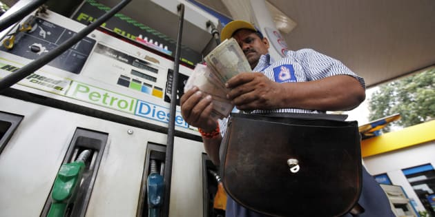 File photo of an employee counting Indian currency at a fuel station in Mumbai.