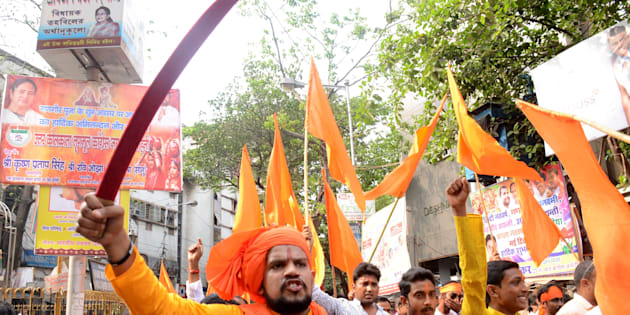 Indian Hindu devotees shouts slogans with sword during the rally on the eve of Ram Navami festival in Kolkata , India on Wednesday , 5th April , 2017.