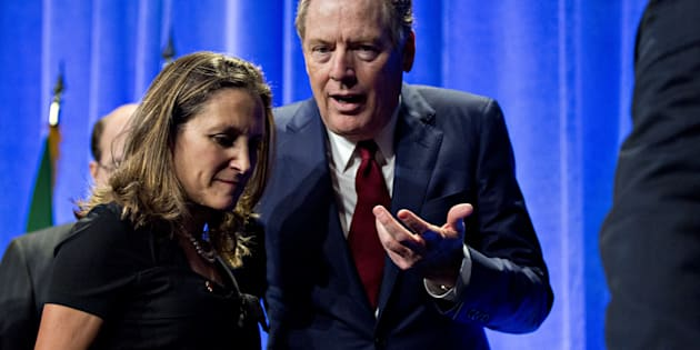 Robert Lighthizer, U.S. trade representative, speaks to Chrystia Freeland, minister of foreign affairs, after opening statements during the first round of North American Free Trade Agreement renegotiations in Washington, D.C., on Aug. 16, 2017.