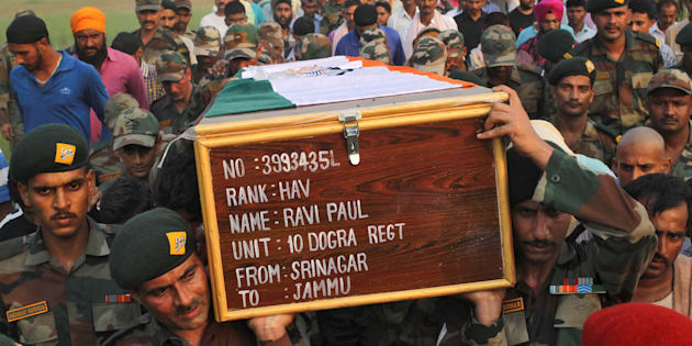Soldiers carry a coffin containing the body of their fallen colleague Ravi Paul, killed in Sunday's attack at an Indian army base in Kashmir's Uri.