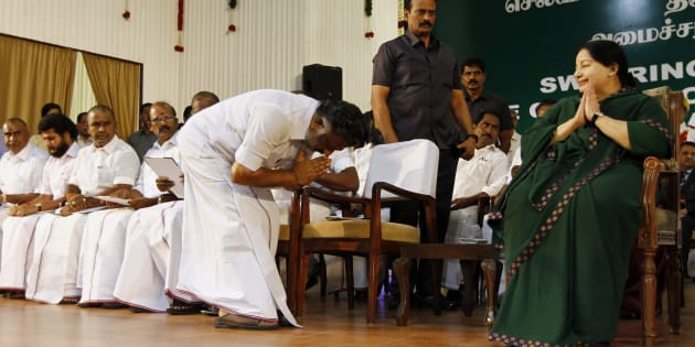 Former chief minister O. Panneerselvam bows in front of AIADMK leader Jayaram Jayalalitha after she took oath as the new Chief Minister of Tamil Nadu state in Chennai, India, Saturday, May 23, 2015.
