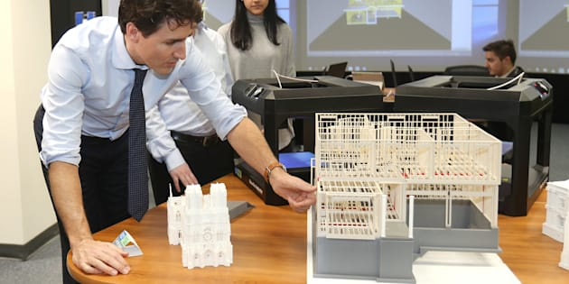 Prime Minister Justin Trudeau looks at construction models created by 3D printers at the George Brown College Casa Loma campus in Toronto, March 23, 2017.