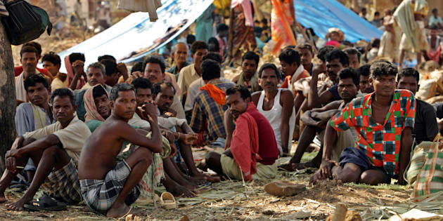 Tribal people sit at a relief camp in Dharbaguda, in the central state of Chhattisgarh, March 8, 2006.   REUTERS/Kamal Kishore