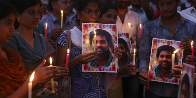 Activist of a Dalit organization participate in a candle light vigil holding photographs of Indian student Rohith Vemula in Hyderabad, India, Wednesday, Jan 20, 2016. (AP Photo/Mahesh Kumar A.)