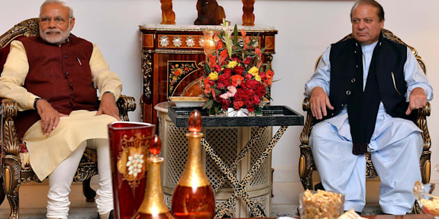 Prime Minister of Pakistan Nawaz Sharif (R) meets with Indian Prime Minister Narendra Modi (L) in Lahore, Pakistan on December 25, 2015. (Photo by Indian Press Information office/Anadolu Agency/Getty Images)