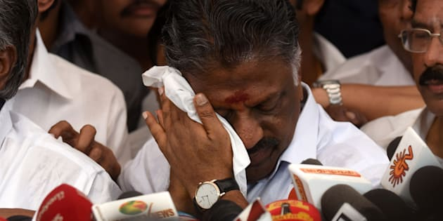 Acting chief minister O Panneerselvam (C) of the southern Indian state of Tamil Nadu gestures during a press conference at his home in Chennai on February 14, 2017. India's Supreme Court jailed the annointed next leader of Tamil Nadu for four years for corruption on February 14, heightening the turmoil in a state still reeling from the death of its long-time matriarch. VK Sasikala was told to surrender immediately to prison authorities after judges overturned her acquittal in a long-running 'disproportionate assets' case that also involved her late mentor Jayalalithaa Jayaram. Sasikala has been involved in a bitter battle in recent weeks with the state's acting chief minister O Panneerselvam who has been trying to block her ascent. / AFP / ARUN SANKAR        (Photo credit should read ARUN SANKAR/AFP/Getty Images)