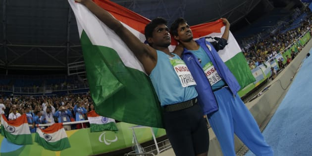 2016 Rio Paralympics - Men's High Jump - T42 Final - Olympic Stadium - Rio de Janeiro, Brazil - 09/09/2016. Gold medalist Mariyappan Thangavelu of India (L) celebrates with compatriot and bronze medal winner Bhati Varun Singh after the event.  REUTERS/Ricardo Moraes  FOR EDITORIAL USE ONLY. NOT FOR SALE FOR MARKETING OR ADVERTISING CAMPAIGNS.