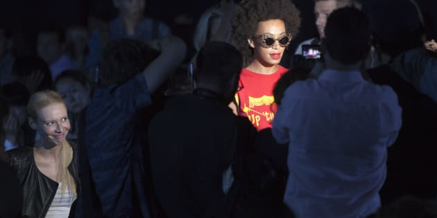 Solange Knowles (R) arrives for the Alexander Wang Spring/Summer 2014 collection during Fashion Week in New York, September 7, 2013. REUTERS/Carlo Allegri  (UNITED STATES - Tags: FASHION ENTERTAINMENT)