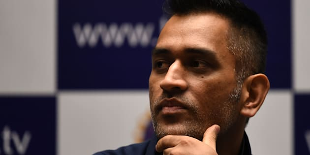 Indian ODI and T20 cricket captain Mahendra Singh Dhoni gestures during a press conference on the eve of the Indian tour of Zimbabwe, in Mumbai on June 7, 2016. / AFP / INDRANIL MUKHERJEE        (Photo credit should read INDRANIL MUKHERJEE/AFP/Getty Images)