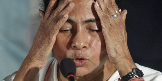 Mamata Banerjee, Chief Minister of India's eastern state of West Bengal, gestures during a news conference after a meeting of her Trinamool Congress party (TMC) in Kolkata September 18, 2012. The biggest ally in Prime Minister Manmohan Singh's government pulled out of the ruling coalition on Tuesday, escalating a political firestorm over big-ticket reform measures launched last week to revive India's flagging economy.