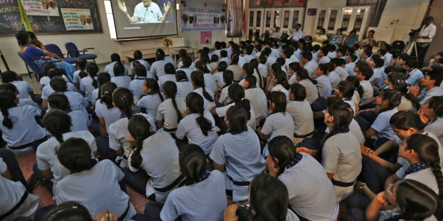 Students in Ahmadabad watch Prime Minister Narendra Modi on screen as he speaks during a nationwide address during Teachers' Day on September 5, 2014. REUTERS/Amit Dave