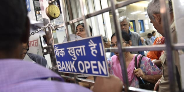 NEW DELHI, INDIA - NOVEMBER 10: Rush at the State Bank of India, Central Market, Lajpat Nagar on the opening of the banks for issuance of new currency on November 10, 2016 in New Delhi, India. It was a manic rush outside most banks across the country on Thursday. People were seen waiting outside many banks as early as 6 a.m. to exchange the now defunct Rs. 500 and Rs. 1,000 notes, deposit them in their accounts and withdraw money. As part of sweeping steps to battle black money, Prime Minister Narendra Modi announced that Rs. 500 and Rs. 1,000 currency notes will cease to be legal tender from midnight of Tuesday. (Photo by Saumya Khandelwal/Hindustan Times via Getty Images)
