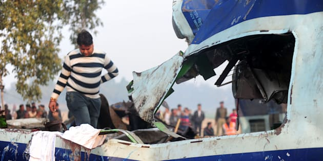 A relative attempts to identify luggage belonging to a family member who was killed in a train accident in Kanpur on November 21, 2016.  Emergency workers raced to find any more survivors in the mangled wreckage of an Indian train that derailed on November 20, killing at least 120 people, in the worst disaster to hit the country's ageing rail network in recent years. Rescue workers were searching for survivors believed still trapped inside the badly mangled coaches of the Patna-Indore express after the crash near Kanpur in Uttar Pradesh state. / AFP / SANJAY KANOJIA        (Photo credit should read SANJAY KANOJIA/AFP/Getty Images)