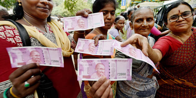 Chennai: Women  show their new Rs 2000 notes after exchanging their old Rs 500 and Rs 1000 notes at a bank in Chennai on Thursday.