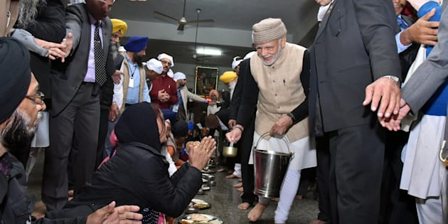 Amritsar: Prime Minister Narendra Modi serves langar during his visit at Golden temple on the eve of the Heart of Asia Conference, in Amritsar on Saturday.