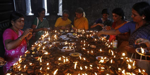 Devotees light earthen oil lamps as they pray to celebrate the Aadi Krithigai festival at a temple in Chennai on 21 July 2014. During the festival, Hindu women fast for the whole day in hope of winning the favour of Lord Muruga. REUTERS/Babu
