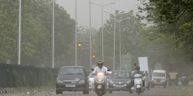 Commuters driving during the dust storm and strong winds, on April 22, 2017 in Chandigarh, India.