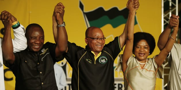 President Jacob Zuma (m) celebrates his re-election as ANC president in 2012 alongside newly-elected party deputy president Cyril Ramaphosa and re-elected chairperson Baleka Mbete.