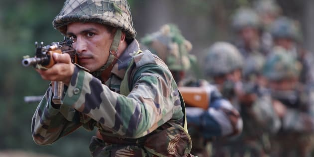Indian army soldiers take positions during their patrol near the Line of Control in Nowshera sector, about 90 kilometers from Jammu, India, Sunday, Oct. 2, 2016. (AP Photo/Channi Anand)
